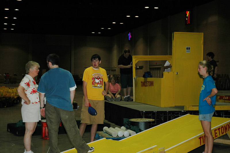 "Volunteers assist in the assembly of ""Tinkletown,"" an informative interactive obstacle course that teaches awareness of everyday challenges those in wheelchairs must face."