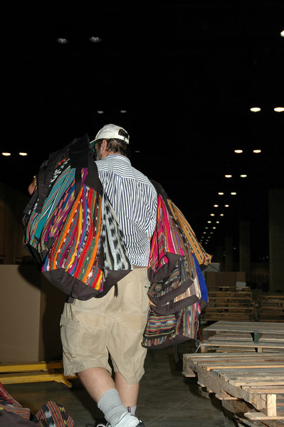 Over 50 volunteers work in assemblyline fashion to load 40,000 backpacks with a Guidebook, Gatheirng Bible, and other inserts to be given to wach attendee of the 2006 ELCA Youth Gathering.