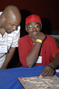 Jason Bennett lends Roger Coleman a hand in a game of Scrabble at the Multicultural Youth Leadership Event, part of the 2006 ELCA Youth Gathering.