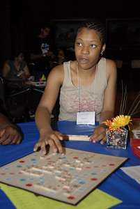 Latoya Brown contemplates her next move in a game of Scrabble at the Multicultural Youth Leadership Event, part of the 2006 ELCA Youth Gathering.