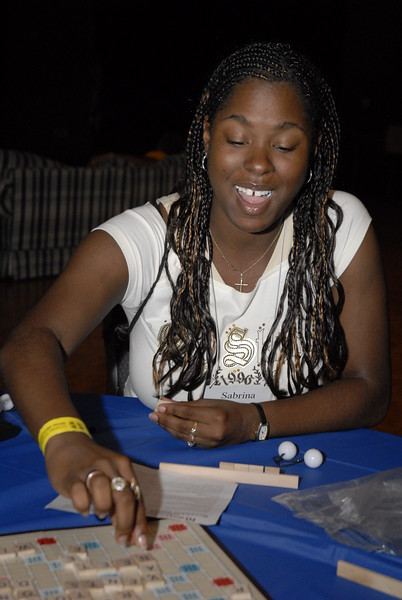 Sabrina McHill tries her skill at a game of Scrabble at the Multicultural Youth Leadership Event, part of the 2006 ELCA Youth Gathering.