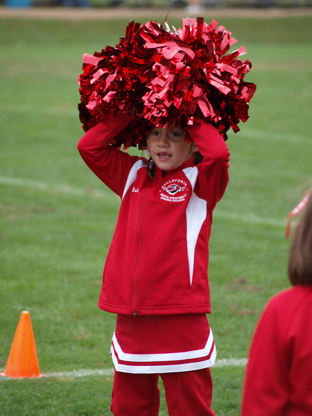 9/26/09...It was a rainy, cold day!  Kaitlyn was using her poms as an umbrella!
