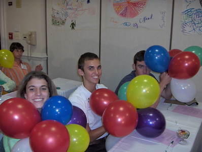 Rebecca, Neal and Denny diplaying their values (balloons) during another workshop.