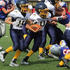 Lynnfield, Ma. 9-10-17. Devin Bolger, 15, and Camden Marengi,11, try to make some yards in Sunday's game against Amesbury at Lynnfield High School.