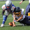 Lynnfield, Ma. 9-10-17.Henry O'Neill from Amesbury and  Camden Marengi from Lynnfield go after a fumble. Camden ended up getting the ball.