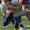 Lynnfiled, Ma. 9-10-17. Steven Dreher faces a face mask by Henry O'Neill from Amesbury in Sunday's game at Lynnfield High.