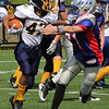 Lynnfield, Ma. 9-10-17. Anthony Attubato tries to run past an Amesbury player in Sunday's game at Lynnfield High School.
