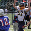 Lynnfield, Ma. 9-10-17. Steven Dreher tries to block a pass thrown by Luke Arsenault of Amesbury in Sunday's game at Lynnfield High School.