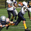 Lynnfield, Ma. 9-10-17. Luke Arsenault of Amesbury grabs Anthony Attubato of Lynnfield by the leg in Sunday's game.