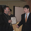 Erik Stryshak receives his Sunday School diploma from Archbishop Khajag Barsamian.
