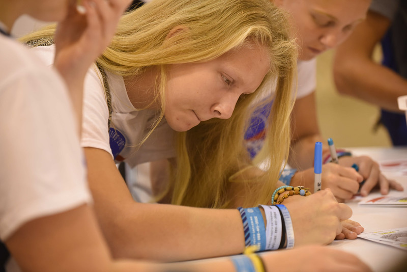 WELCA @ 2018 ELCA Youth Gathering   Courtni Nielsen, First Lutheran, Marshall, Minn., writes on her compassion card.