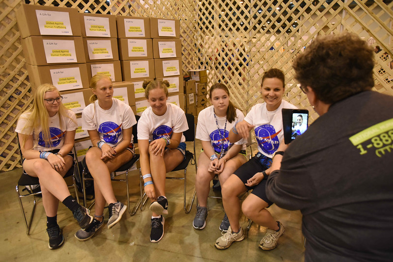 "WELCA @ 2018 ELCA Youth Gathering | Sara Larson (far right), Churchwide executive board member, Women of the ELCA, recorded a Facebook live video. Linda Post Bushkofsky interviewed thier group about preparing to attend the youth gathering. They told her that they made a covenant to go 9 days without their cell phones while in Houston. They said, ""The break is good and [they learned] that you don't need it to survive.""<br /> Pictured from the left: Gabby Reese, Aubrey Bjella, Olivia Peterson, Avery Anderson."