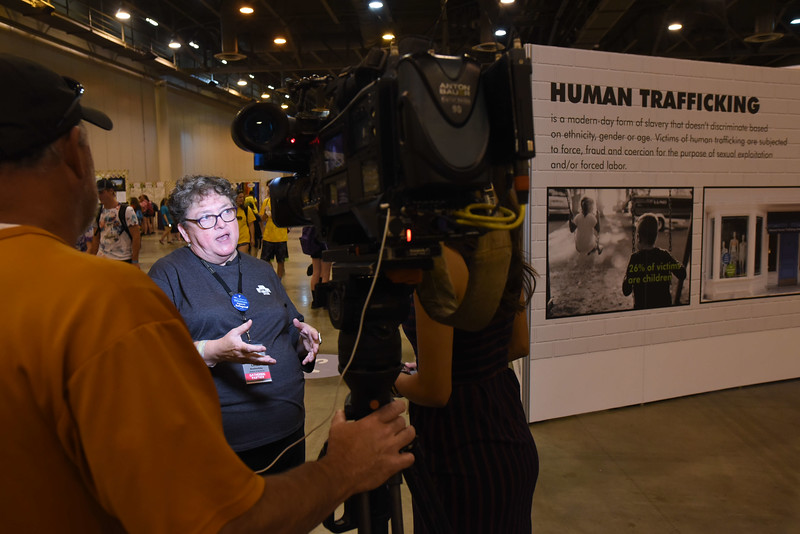 WELCA @ 2018 ELCA Youth Gathering |  Linda Post Bushkofky, executive director, Women of the ELCA, talks with a reporter from Fox News, Houston, about the work the organization has been doing about human trafficking for the last 10 years.