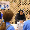 WELCA @ 2018 ELCA Youth Gathering | Jennifer DeLeon, Director for Justice, Women of the ELCA, shares instructions about filling the bags that will be donated to United Against Human Trafficking. Each hygiene bag contains: one towel, body lotion, shampoo and conditioner, hand sanitizer, toothpaste, one toothbrush, deodorant, and body wash, one pamphlet with resources and a compassion card.