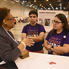 WELCA @ 2018 ELCA Youth Gathering | Eva Yeo talks with Matteo Machado and Anna Olivia Machado, Reformation Lutheran, Media, Pa., learn how the compassion cards will be used.