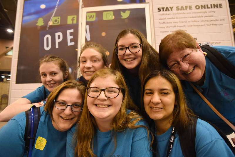 WELCA @ 2018 ELCA Youth Gathering | Penny Courtney (right), St. John Lutheran, Linthicum, Md., adult leader, poses with her group.