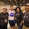 WELCA @ 2018 ELCA Youth Gathering | Sarah Larson, Churchwide executive board memeber, stops by the exhibit and poses with Linda Post Bushkofsky (pictured left), Gabriela Contreras and Eva Yeo, staff, Women of the ELCA.