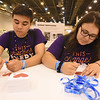 WELCA @ 2018 ELCA Youth Gathering | Matteo Machado and Anna Olivia Machado, Reformation Lutheran, Media, Pa., write messages of blessings.