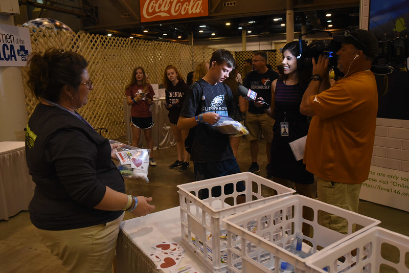 WELCA @ 2018 ELCA Youth Gathering   Tyler Lamb, St. Paul Lutheran, Lititz, Pa., spoke with a reporter from Fox News, Houston about his experience in the Women of the ELCA exhibit.