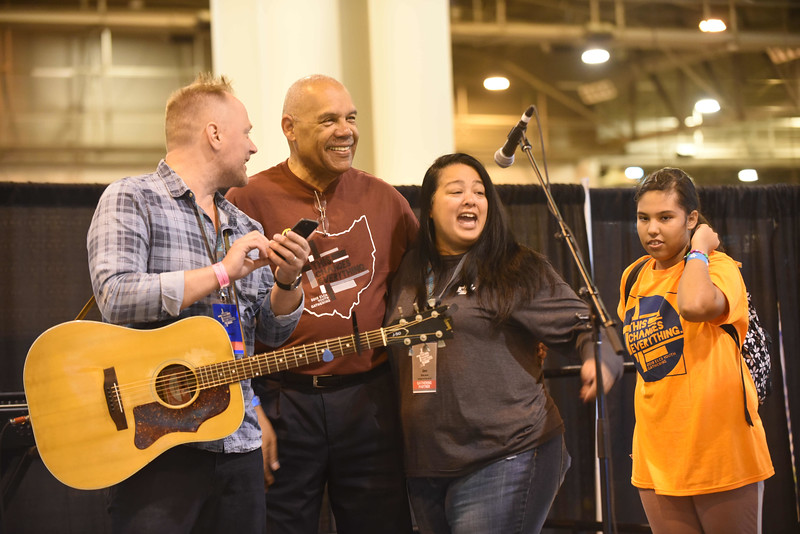 WELCA @ 2018 ELCA Youth Gathering | Jennifer DeLeon, director for Justice, Women of the ELCA, sings at a small stage when she hears one of  her favorite songs.