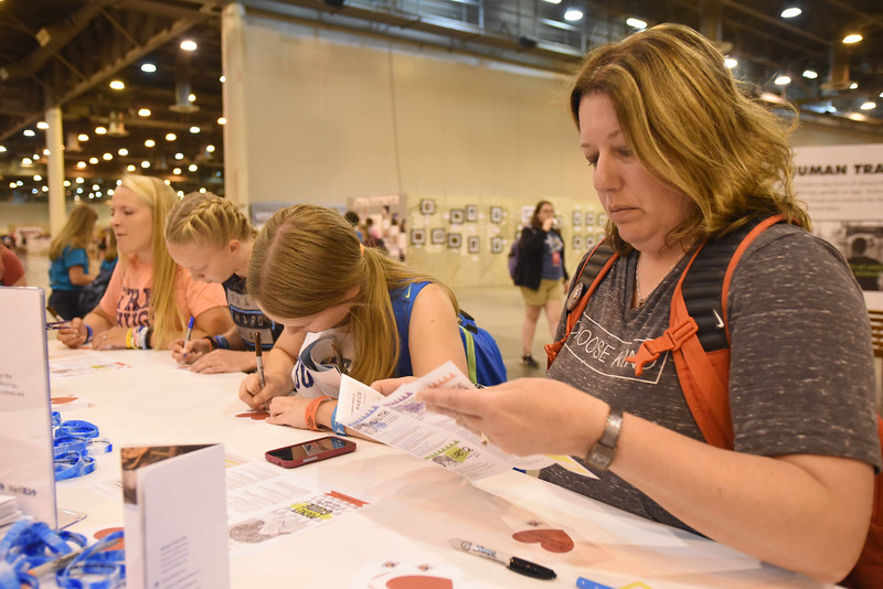 WELCA @ 2018 ELCA Youth Gathering   Dana Kemberling, Sharon Lutheran, Selinsgrove, Pa., folds resources that will be added to every hygiene bag.