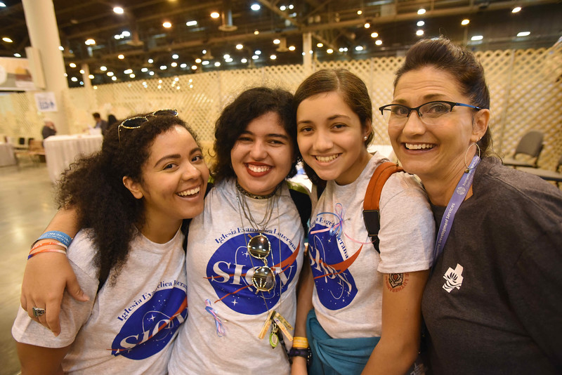 WELCA @ 2018 ELCA Youth Gathering | Yaledma Ayala (left), Sara Vazquez and Andrea Jimenez, Iglesia Evangelica Lutherana Sion, Bayamon, Puerto Rico., bring greetings to Lisa Plorin, churchwide executive board president, Women of the ELCA, from Lydia Davila (not pictured), Andrea's grandmother who is also on the churchwide executive board.