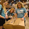 WELCA @ 2018 ELCA Youth Gathering | Caitlyn Morrissey, Dylan Morrissey and Sara Hoekstra, Nativity Lutheran, Palm Beach Gardens, Fla., help tape boxes that will be picked up by staff from United Against Human Trafficking.