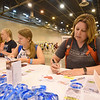 WELCA @ 2018 ELCA Youth Gathering | Dana Kemberling, Sharon Lutheran, Selinsgrove, Pa., writes a message on a compassion card that will be added to the hygiene bags.