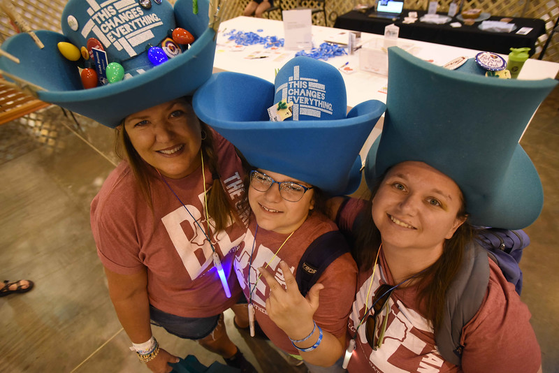 WELCA @ 2018 ELCA Youth Gathering | Linda Barrier, Holly Rewitzer, Cassandra Cook, Memorial Lutheran, St. Augustine, Fla., don big hats while visiting the Women of the ELCA space.