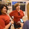 "WELCA @ 2018 ELCA Youth Gathering |  Tina Rosenbaum (left) and Sarah Kribs, Shepherd of Life Lutheran, Arlington, Tx., talk about how their ""pocket Jesus"" t-shirts came to be."