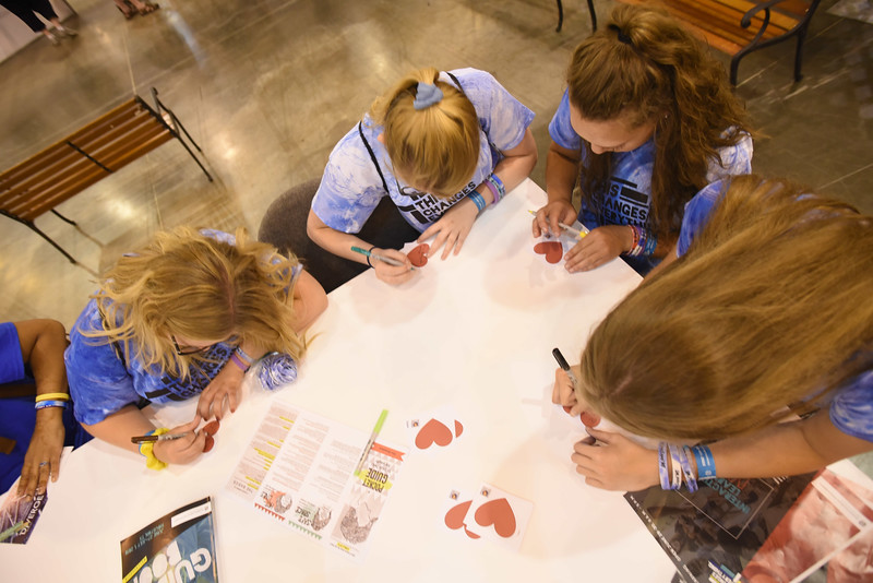 WELCA @ 2018 ELCA Youth Gathering | At the compassion station, youth write messages of hope and kindness on hearts that will be included in every hygiene bag.