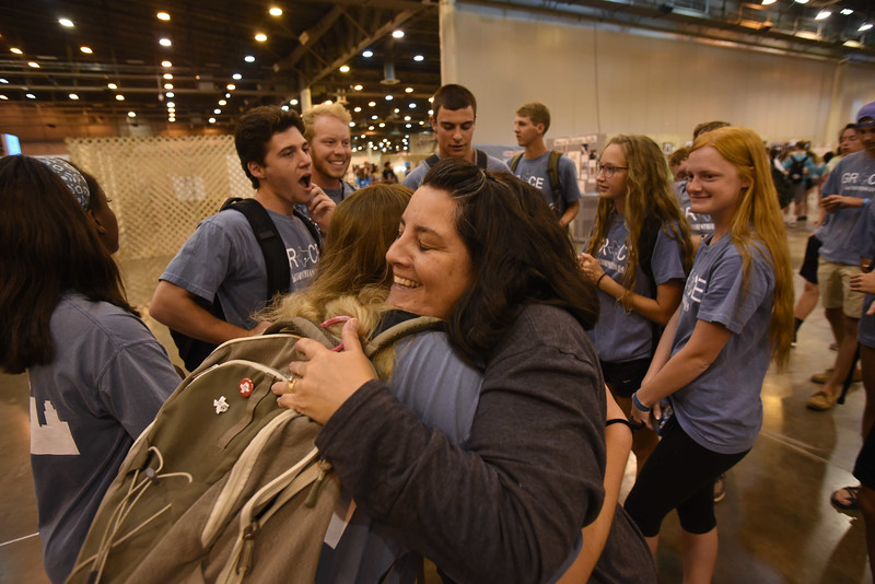 WELCA @ 2018 ELCA Youth Gathering | Amy Ellis, an active WELCA participant who volunteered to work in our space, greets the youth from her congregation in Texas.