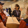 WELCA @ 2018 ELCA Youth Gathering | Lisa Plorin, Churchwide executive board president, Women of the ELCA gets some help moving the filled boxes.