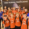 WELCA @ 2018 ELCA Youth Gathering | Visitors to our exhibit pose in front of our End Human Trafficking sign with two staff from United Against Human Trafficking, a Houston-based organization that provides services for victims of human trafficking.