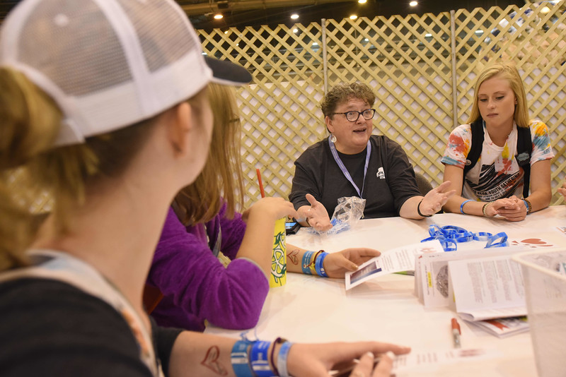 WELCA @ 2018 ELCA Youth Gathering   Linda Post Bushkofsky talks to the group before they fold street outreach brochures that will be placed in every bag.