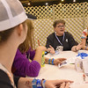 WELCA @ 2018 ELCA Youth Gathering | Linda Post Bushkofsky talks to the group before they fold street outreach brochures that will be placed in every bag.