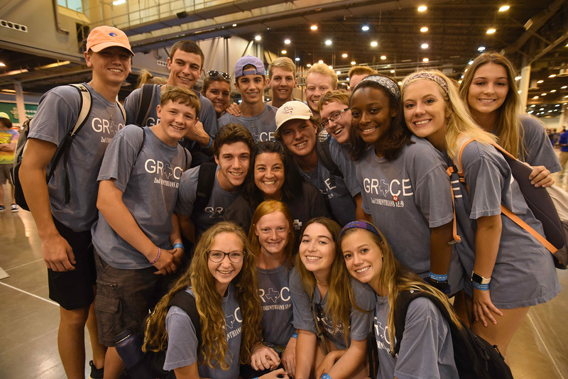 WELCA @ 2018 ELCA Youth Gathering |  Amy Ellis, an active WELCA participant who volunteered to work in our space, poses with the youth from her congregation in Texas.