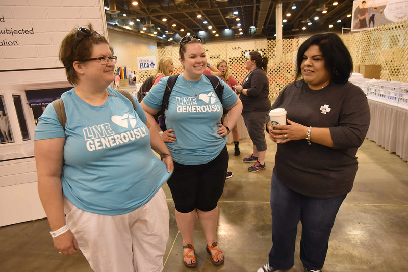 WELCA @ 2018 ELCA Youth Gathering | Julie Bever and Pastor Luci Sesvold, Bethany Lutheran, Rice Lake, Wisc., talk with Gabriela Contreras,  about the ways Women of the ELCA is working to end human trafficking.