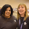 WELCA @ 2018 ELCA Youth Gathering |  Gabriela Contreras and Elizabeth McBride, Women of the ELCA staff take a break to smile for the camera.