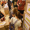 WELCA @ 2018 ELCA Youth Gathering | Visitors to the exhibit helped label and stack the boxes that will be donated to United Against Human Trafficking.