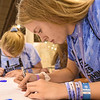 WELCA @ 2018 ELCA Youth Gathering | Emily Goodbrand, Trinity Lutheran, Loyal, Wisc., write messages of hope and kindness on hearts that will be added to every hygiene bag.