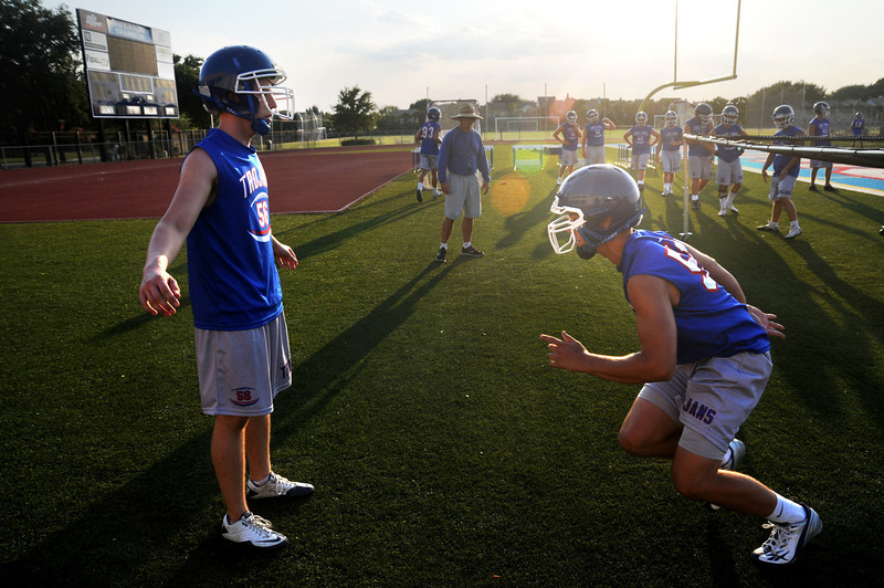 The TCA-Addison football teams practices in the record-breaking North Texas heat at Tom Landry Stadium in Addison, Texas on Wednesday, August 3, 2011.  The high for the day was 109 degrees.