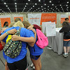 Women of the ELCA @ ELCA Youth Gathering | Detroit, Michigan, July 15-19 2015 | Danielle Miller, Lizzy Hellsten and Maddie Franklin, Christ the Lord, Lawrenceville, Ga., pray before making inkind gifts.