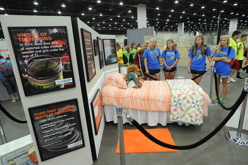 Women of the ELCA @ ELCA Youth Gathering | Detroit, Michigan, July 15-19 2015 | Lizzy Hellsten, Maddie Franklin, Danielle Miller, Claire Fitzpatrick, Maddie Venzon, Christ the Lord in Lawrenceville, Ga., read the stats on the bedroom wall about signs to look for if someone is trafficked.