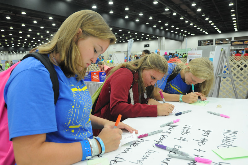 Women of the ELCA @ ELCA Youth Gathering | Detroit, Michigan, July 15-19 2015 | Danielle Miller, Lizzy Hellsten, Maddie Venzon, Christ the Lord, Lawrenceville, Ga. write notes of encouragement for the in-kind gifts.