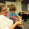 Women of the ELCA @ ELCA Youth Gathering | Detroit, Michigan, July 15-19 2015 | Linda Post Bushkofsky asks her granddaughter Jordyn, to test Women of the ELCA's Daily Grace app on her phone.