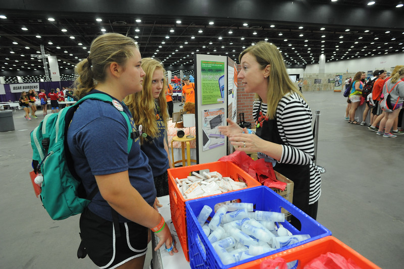 Elizabeth McBride, right, talks with youth gathering participants about the human trafficking exhibit. Women of the ELCA @ ELCA Youth Gathering | Detroit, Michigan, July 15-19 2015 |