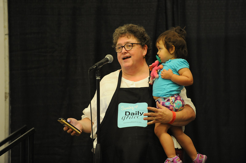Women of the ELCA @ ELCA Youth Gathering | Detroit, Michigan, July 15-19 2015 | Linda Post Bushkofsky accompanied by her granddaughter, Jordyn, introduces one of the first representatives from local anti-trafficking organizations in Detroit who will speak to the adult leaders in the cafe.