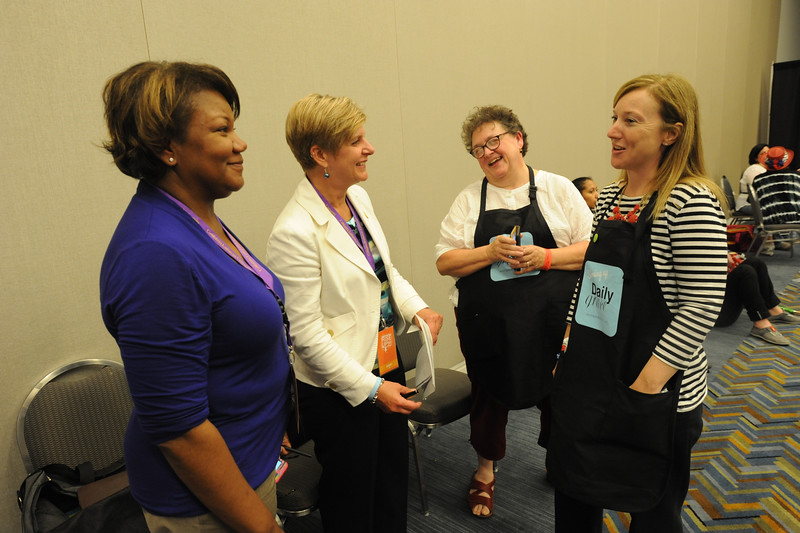 Women of the ELCA @ ELCA Youth Gathering | Detroit, Michigan, July 15-19 2015 | Kelly Small, Angela Aufderberge, Vista Maria, talk with Women of the ELCA staff, Linda Post Bushkofsky and Elizabeth McBride about how they helped to shape programming for the Women of the ELCA exhibit