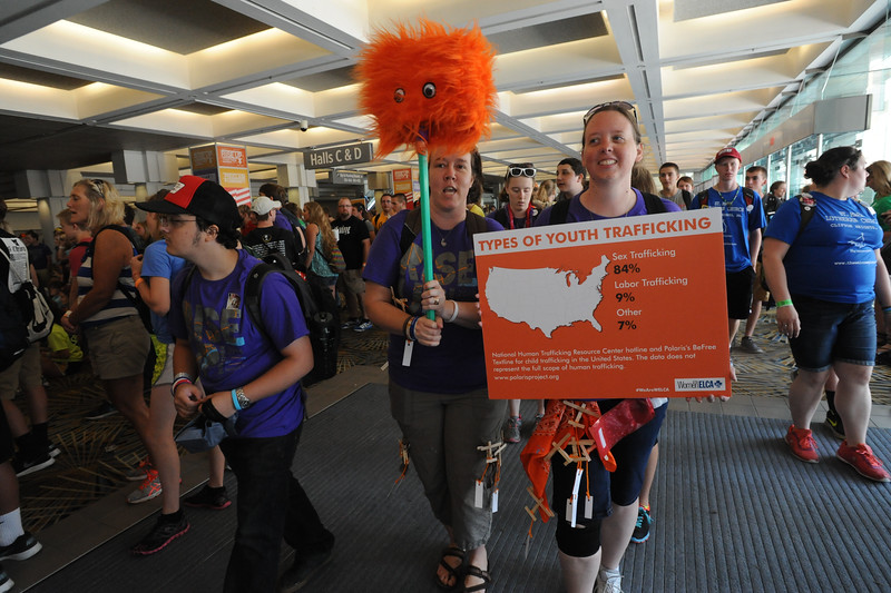 Women of the ELCA @ ELCA Youth Gathering | Detroit, Michigan, July 15-19 2015 | Julie Barichivich and Jennifer Hogan, Faith Lutheran, Warner Robins, Ga. carry signs to spread awareness about human trafficking.